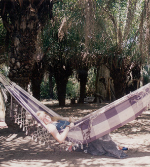 Estagiária Justyna relaxing in a hammock during her first visit to Pantanal, Mato Grosso do Sul, Brazil, 1999